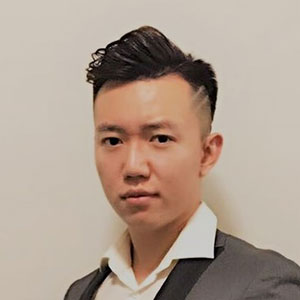 Headshot of male Asian student in a suit