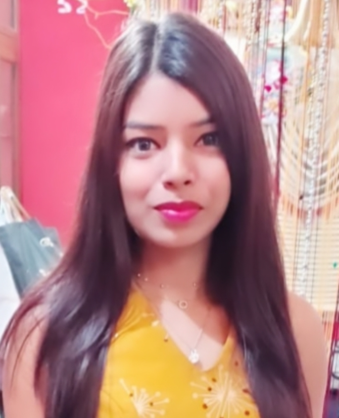 Headshot of Indian female in a yellow tank top