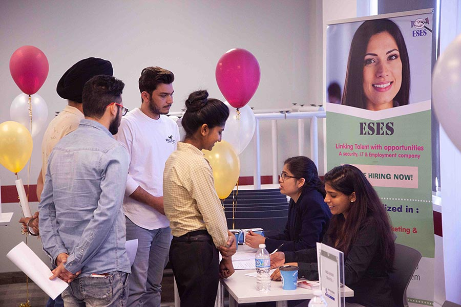 Hanson College Students Networking at a Career Fair