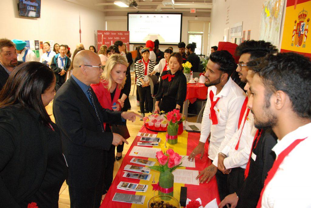 Provincial MPP Vincent Ke talking with student presenters